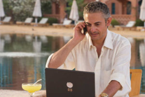 A businessman handles his work from Mosaique Beach Resort in Taba Heights
